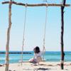 A girl seated on the 'Yurari' Driftwood Swing